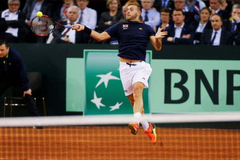 Great Britain's Daniel Evans hits a return to French Jeremy Chardy during their single match of the Davis Cup World Group quarterfinals on April 7, 2017 in Rouen
