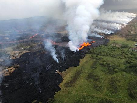 Aerial view of erupting fissure 22 and lava channels flowing southward from the fissure is seen from the air during an early morning overflight during ongoing eruptions of the Kilauea Volcano in Hawaii, U.S. May 21, 2018.  Courtesy Volcano Helicopters/USGS/Handout via REUTERS