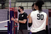 Volleyball coach Joe Trinsey speaks as outside hitter Odina Aliyeva (90) and others listen during practice in Dallas, Wednesday, Feb. 24, 2021. (AP Photo/Tony Gutierrez)