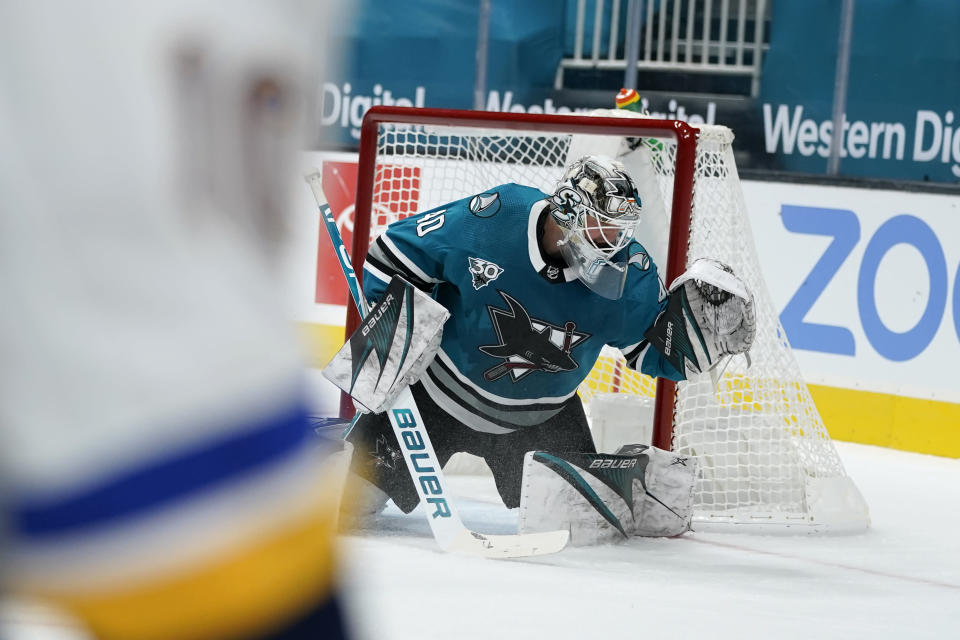 San Jose Sharks goaltender Devan Dubnyk can't stop a goal by St. Louis Blues center Brayden Schenn during the second period of an NHL hockey game in San Jose, Calif., Saturday, Feb, 27, 2021. (AP Photo/Tony Avelar)