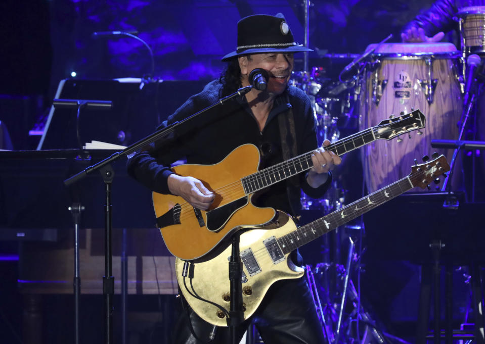 Santana performs on stage at the Pre-Grammy Gala And Salute To Industry Icons at the Beverly Hilton Hotel on Saturday, Jan. 25, 2020, in Beverly Hills, Calif. (Photo by Willy Sanjuan/Invision/AP)