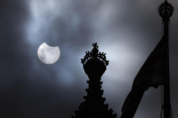 A partial solar eclipse is seen over the Houses of Parliament on June 10, 2021, in London, England. / Credit: Dan Kitwood / Getty Images