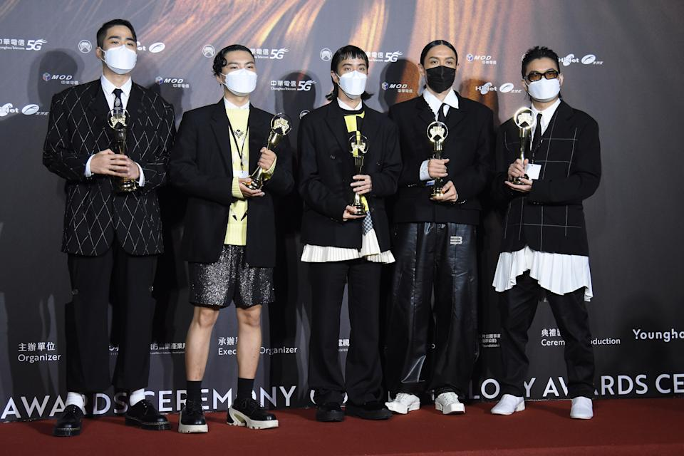 TAIPEI, CHINA - AUGUST 21: Members of Taiwanese band Sunset Rollercoaster pose with trophies backstage during the 32nd Golden Melody Awards on August 21, 2021 in Taipei, Taiwan of China. (Photo by Chen Lihong/VCG via Getty Images)