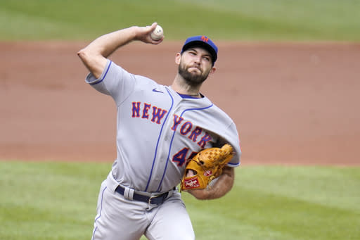 New York Mets starting pitcher Michael Wacha throws a pitch to the Baltimore Orioles during the second inning of a baseball game, Wednesday, Sept. 2, 2020, in Baltimore. (AP Photo/Julio Cortez)