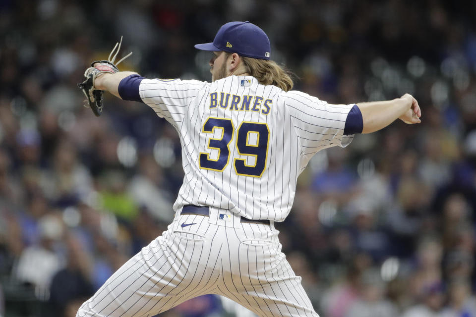 Milwaukee Brewers' Corbin Burnes pitches during the first inning of a baseball game against the New York Mets Saturday, Sept. 25, 2021, in Milwaukee. (AP Photo/Aaron Gash)