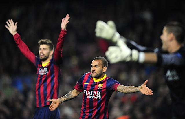 Barcelona's Gerard Pique, Daniel Alves and goalkeeper Victor Valdes, from left to right, gesture during a Champions League, round of 16, second leg, soccer match between FC Barcelona and Manchester City at the Camp Nou Stadium in Barcelona, Spain, Wednesday March 12, 2014. (AP Photo/Manu Fernandez)