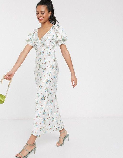 """<p><strong>ASOS</strong></p><p>www.asos.com</p><p><strong>$56.00</strong></p><p><a href=""""https://go.redirectingat.com?id=74968X1596630&url=https%3A%2F%2Fwww.asos.com%2Fus%2Fasos-design%2Fasos-design-satin-twist-front-bias-midi-tea-dress-with-puff-sleeves%2Fprd%2F14599693%3FCTARef%3DSaved%2BItems%2BImage&sref=https%3A%2F%2Fwww.marieclaire.com%2Ffashion%2Fg32662286%2Faffordable-sundresses%2F"""" rel=""""nofollow noopener"""" target=""""_blank"""" data-ylk=""""slk:Shop Now"""" class=""""link rapid-noclick-resp"""">Shop Now</a></p><p>This slip dress accented with puff sleeves is a perfect option for an champagne sipping, outdoor brunch. Accessorize with a <a href=""""https://www.asos.com/us/asos-design/asos-design-hammond-strappy-mid-heeled-sandals-in-yellow/prd/14595378?colourwayid=16628681&SearchQuery=&cid=6458"""" rel=""""nofollow noopener"""" target=""""_blank"""" data-ylk=""""slk:low heel shoe"""" class=""""link rapid-noclick-resp"""">low heel shoe</a> and a <a href=""""https://www.asos.com/us/asos-design/asos-design-padded-quilt-bag-in-mint/prd/14284820?colourwayid=16605150&SearchQuery=&cid=8730"""" rel=""""nofollow noopener"""" target=""""_blank"""" data-ylk=""""slk:mini bag"""" class=""""link rapid-noclick-resp"""">mini bag</a> for all your essentials and you're out the door. </p>"""