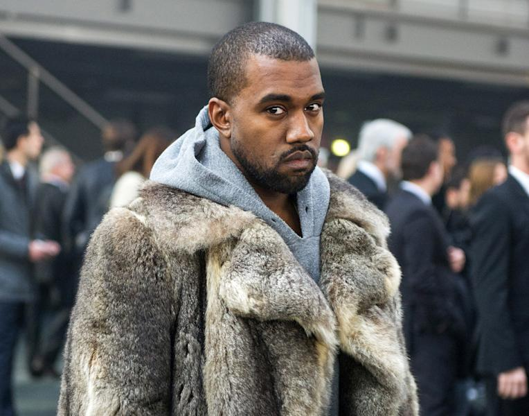 FILE - This Jan. 17, 2014 file photo shows singer Kanye West as he arrives for the Givenchy men's Fall-Winter 2014-2015 fashion collection in Paris. South By Southwest has slipped into hyperdrive as the music portion of the annual conference and festival opens this week. Kanye West and Jay Z have announced they're headed to Austin, Texas. They will appear along with Kendrick Lamar, Lil Wayne, Rick Ross, Nas, 50 Cent, Tyler, the Creator, Earl Sweatshirt, 2 Chainz, Future, Action Bronson, Childish Gambino and ScHoolboy Q, after his new album opened at No. 1. (AP Photo/Zacharie Scheurer, File)