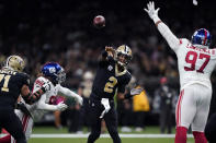 New Orleans Saints quarterback Jameis Winston (2) passes under pressure from New York Giants defensive tackle Dexter Lawrence (97) in the first half of an NFL football game in New Orleans, Sunday, Oct. 3, 2021. (AP Photo/Brett Duke)