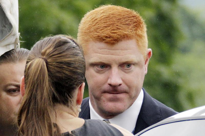 Penn State University assistant football coach Mike McQueary arrives at the Centre County Courthouse to testify in the child sexual abuse trial of former Penn State University assistant football coach Jerry Sandusky in Bellefonte, Pa., Tuesday, June 12, 2012. Sandusky is charged with 52 counts of child sexual abuse involving 10 boys over a period of 15 years. (AP Photo/Gene J. Puskar)