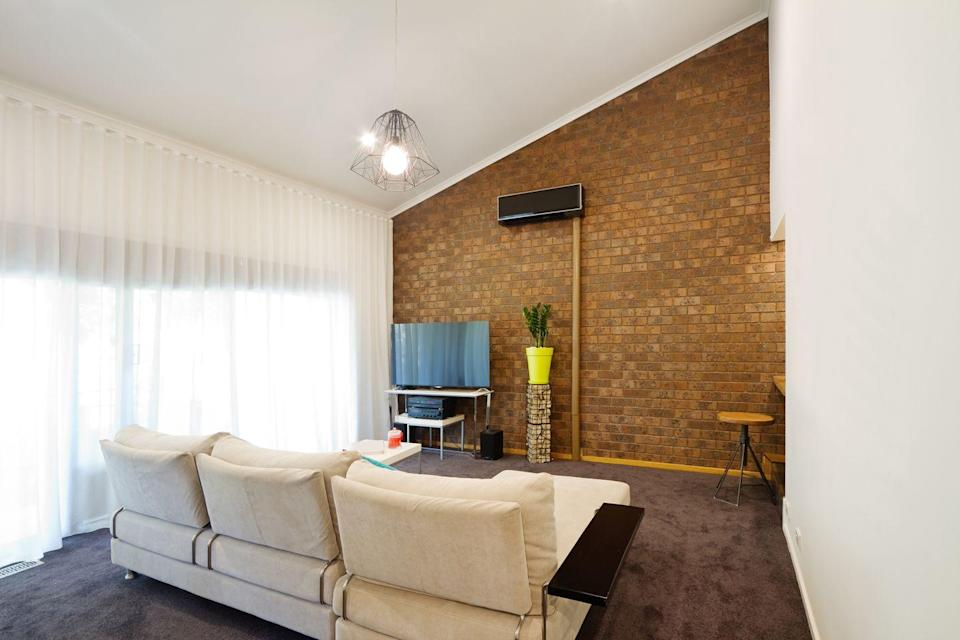 <p>Exposed brick was so popular in the 70s, you'd have thought everyone was bunking in an old warehouse. Add in an angled roofline and its twice the time trip back.</p>