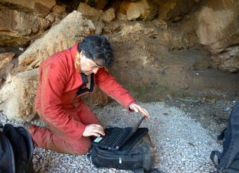 Archeologist Hipolito Collado checks the data prior to entering the Maltravieso Cave on the outskirts of Caceres