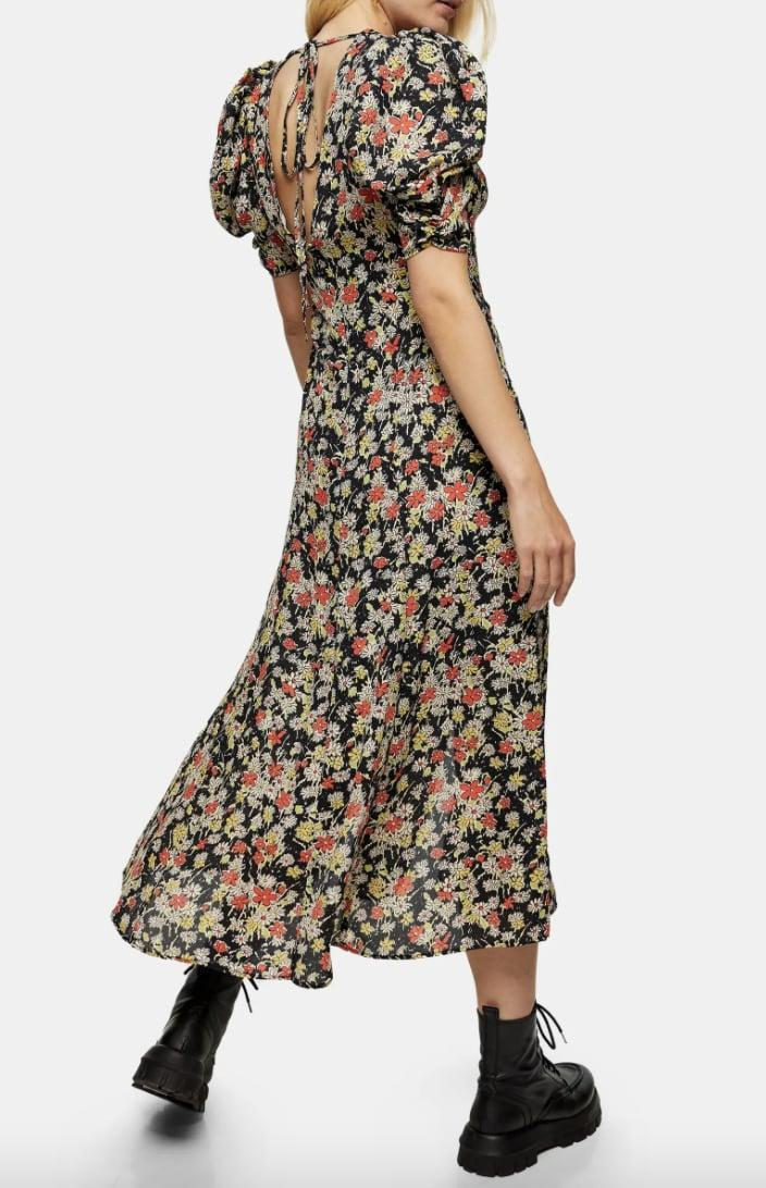 <p>Channel your inner rebel in this <span>Topshop Grunge Floral Print Midi A-Line Dress</span> ($45, originally $90) paired with chunky boots.</p>