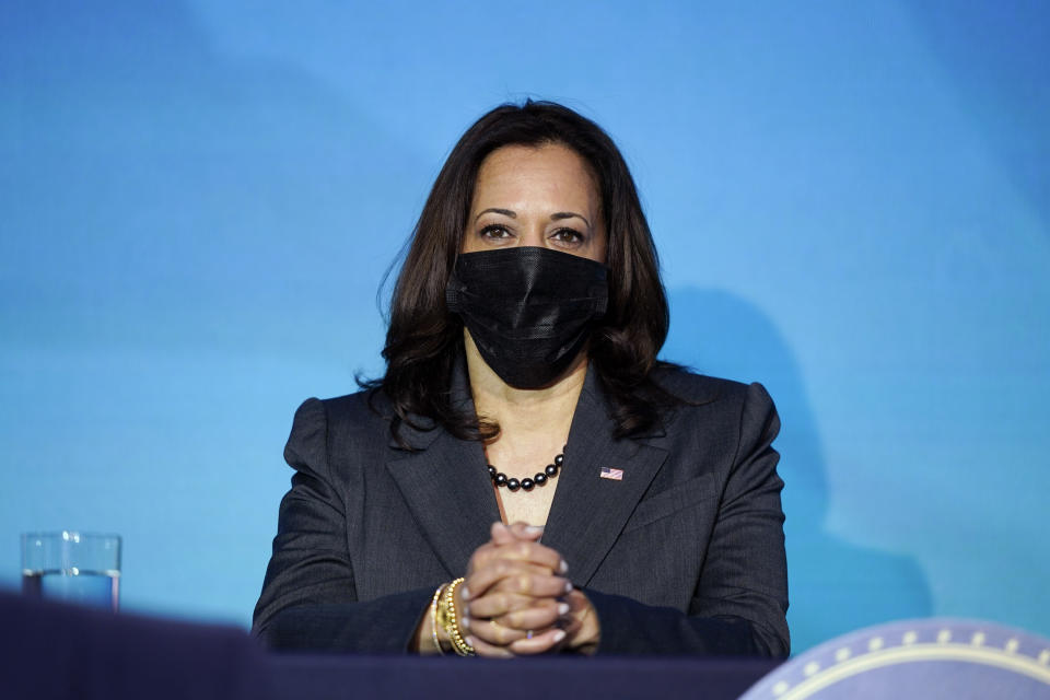 Vice President-elect Kamala Harris listens as President-elect Joe Biden announces their climate and energy team nominees and appointees at The Queen Theater in Wilmington Del., Saturday, Dec. 19, 2020. (AP Photo/Carolyn Kaster)