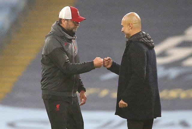Liverpool manager Jurgen Klopp (left) and Manchester City manager Pep Guardiola meet at Anfield on Sunday.