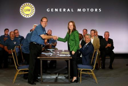 General Motors Chairman and CEO Mary Barra shakes hands with United Auto Workers President Gary Jones at the start of contract talks between the union and automaker in Detroit,
