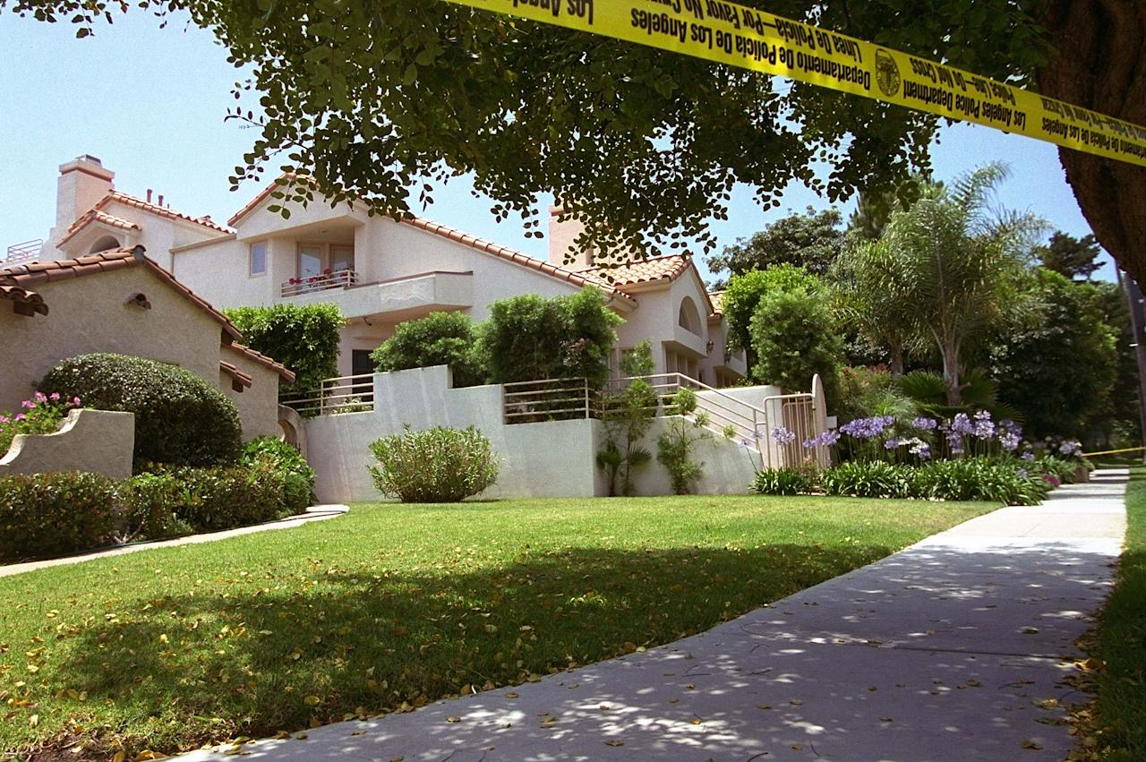 <p>Police tape surrounds the Bundy Drive home of Nicole Brown Simpson, ex-wife of former NFL great O.J. Simpson after she apparently was murdered late Sunday June 12, 1994. (Photo: Eric Draper/AP) </p>