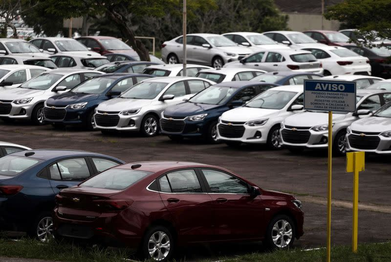 Cars are pictured at the General Motors Co plant, that will give time off to its employees during the coronavirus disease (COVID-19) outbreak, in Sao Jose dos Campos