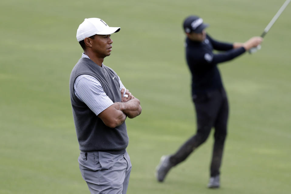 Tiger Woods, left, watches opponent Patrick Cantlay, right, on the second hole during round-robin play at the Dell Technologies Match Play Championship golf tournament, Friday, March 29, 2019, in Austin, Texas. (AP Photo/Eric Gay)