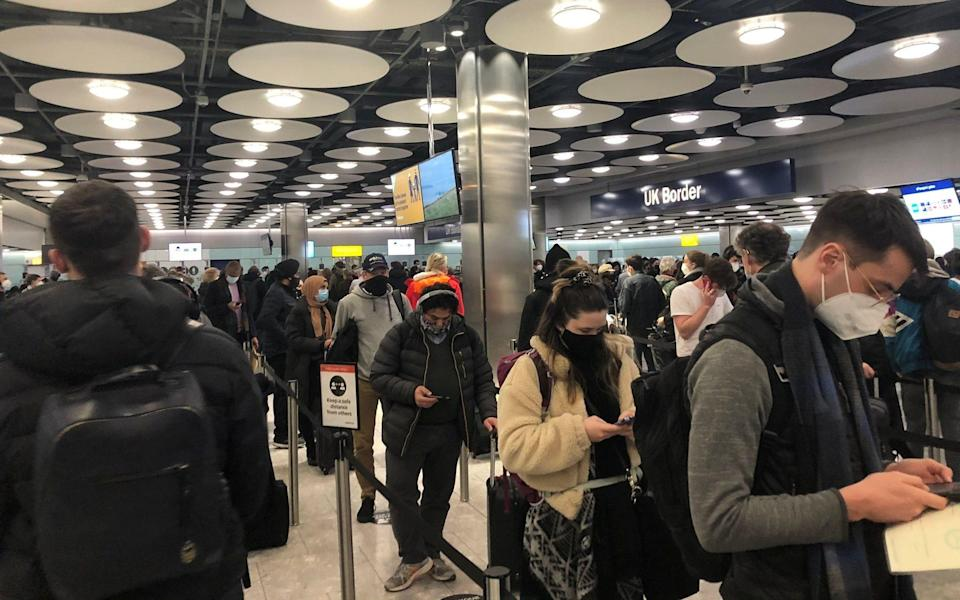People queue at terminal 5 of Heathrow Airport on January 22 as the spread of the coronavirus disease continues - PIA JOSEPHSON via REUTERS