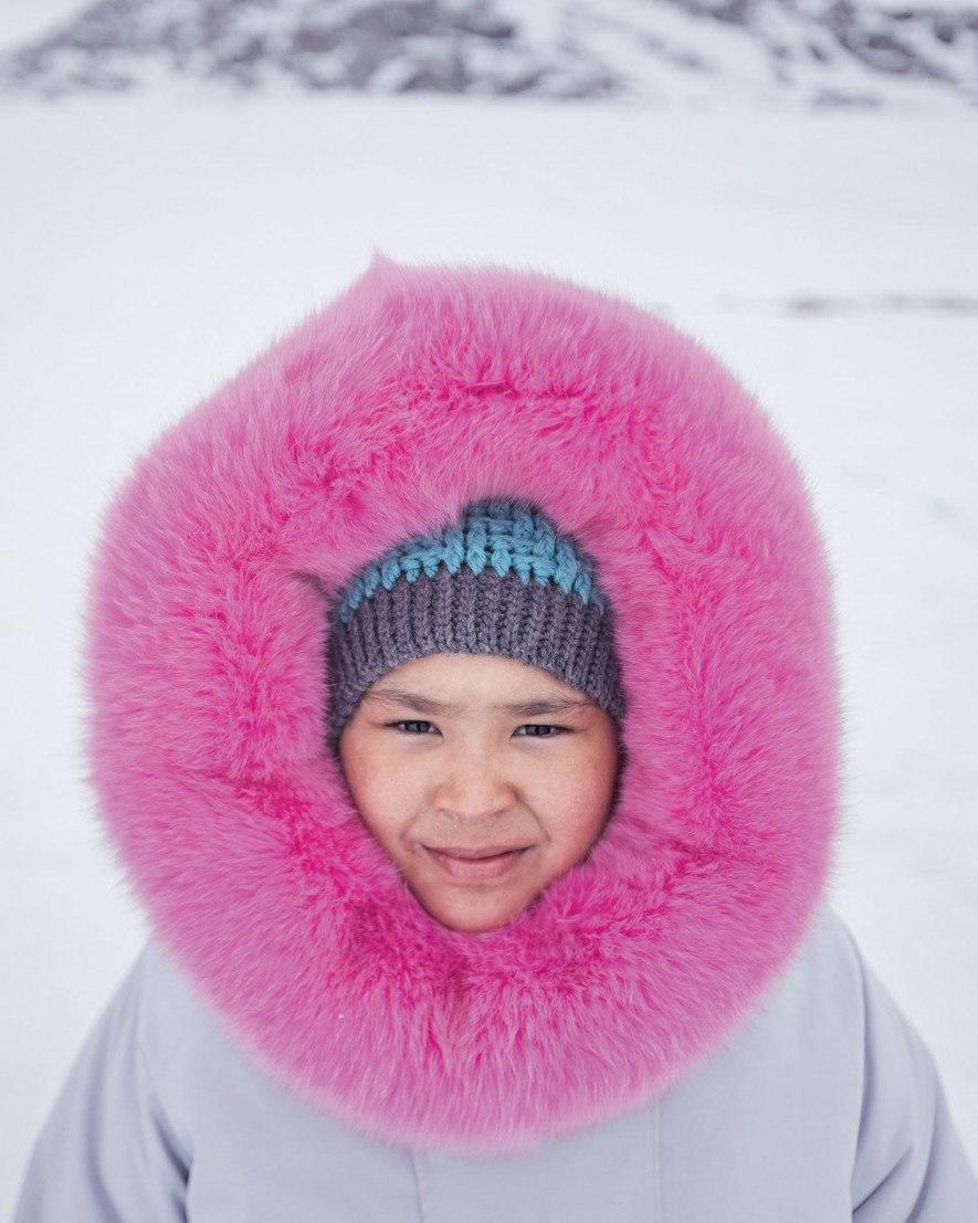 Wearing a parka sewn by her mother, Ashley Hughes spent her 10th birthday camping with friends and family at Ikpikittuarjuk Bay. Hughes took part in the Inuit community's annual ice fishing competition for arctic char. (National Geographic/David Guttenfelder)