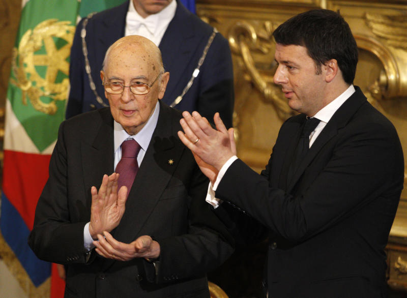 Italian President Giorgio Napolitano, left, and Premier Matteo Renzi, applaud at the end of a swearing in ceremony of the new government at the Quirinale Presidential Palace, in Rome, Saturday, Feb. 22, 2014. Renzi has been sworn in as Italy's youngest premier, heading a new government he says promises will swiftly tackle old problems. (AP Photo/Andrew Medichini)