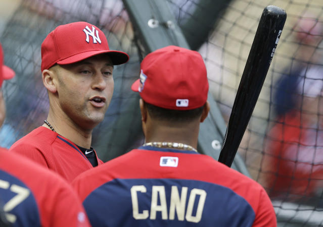 American League short stop Derek Jeter, of the New York Yankees, left, talks with teammate second baseman Robinson Cano, of the Seattle Mariners, during batting practice for the MLB All-Star baseball game, Monday, July 14, 2014, in Minneapolis. (AP Photo/Jeff Roberson)