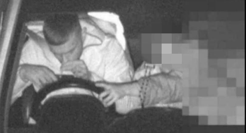 A driver was captured on a mobile phone detection camera appearing to sniff a substance off his phone. Source: NSW Police