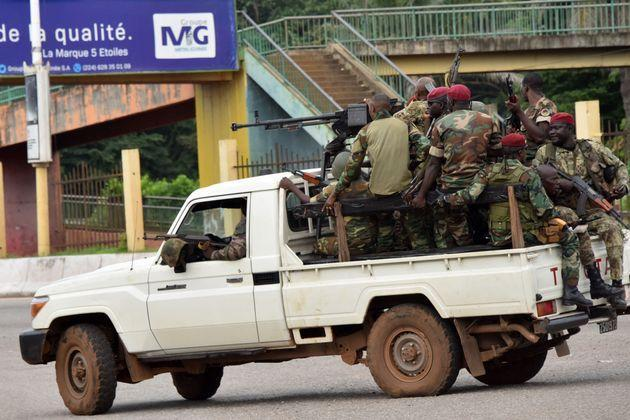 Members of the Armed Forces of Guinea drive through the central neighbourhood of Kaloum in Conakry on September 5, 2021 after sustainable gunfire was heard. - Gunfire was heard in Conkary in the morning and troops were seen on the streets, witnesses told AFP. There was no immediate explanation for the incidents in Conakry's Kaloum peninsula, where the presidency, various institutions and offices are located. (Photo by CELLOU BINANI / AFP) (Photo by CELLOU BINANI/AFP via Getty Images) (Photo: CELLOU BINANI via Getty Images)