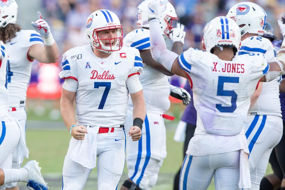 SMU Mustangs QB Shane Buechele (#7) and RB Xavier Jones (#5) celebrate as the final whistle blows during a game against TCU. (Getty)