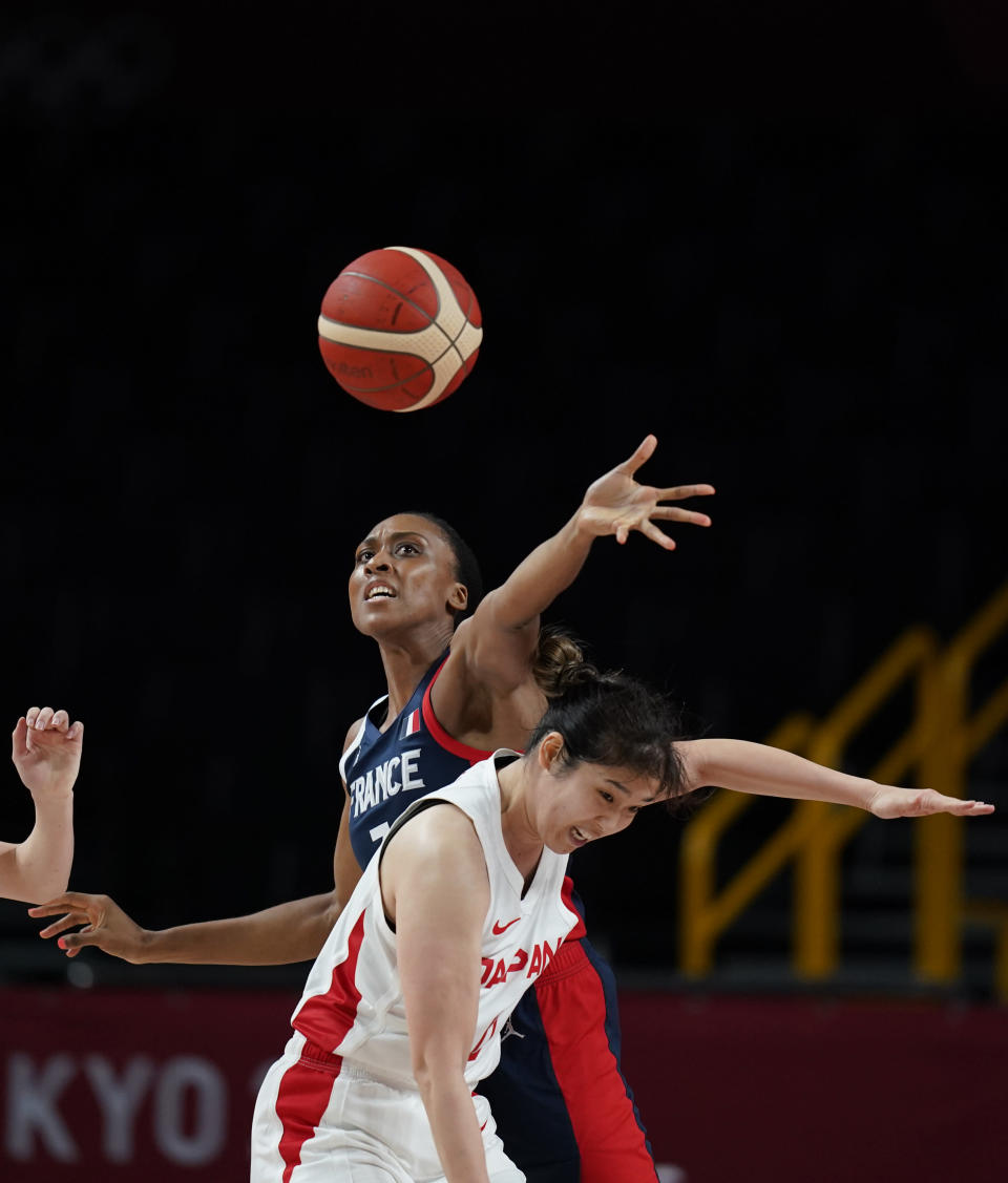 France's Sandrine Gruda (7), left, and Japan's Moeko Nagaoka (0) fight to grab the rebound during women's basketball preliminary round game at the 2020 Summer Olympics, Tuesday, July 27, 2021, in Saitama, Japan. (AP Photo/Charlie Neibergall)