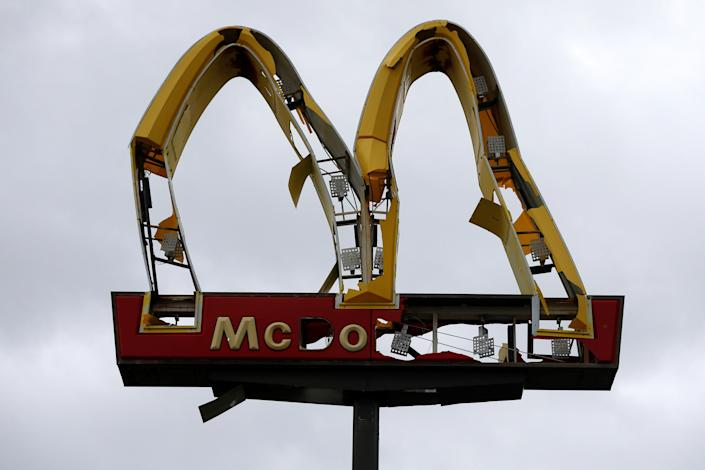 <p>A McDonald's sign damaged by Hurricane Michael is pictured in Panama City Beach, Fla., Oct.10, 2018. (Photo: Jonathan Bachman/Reuters) </p>
