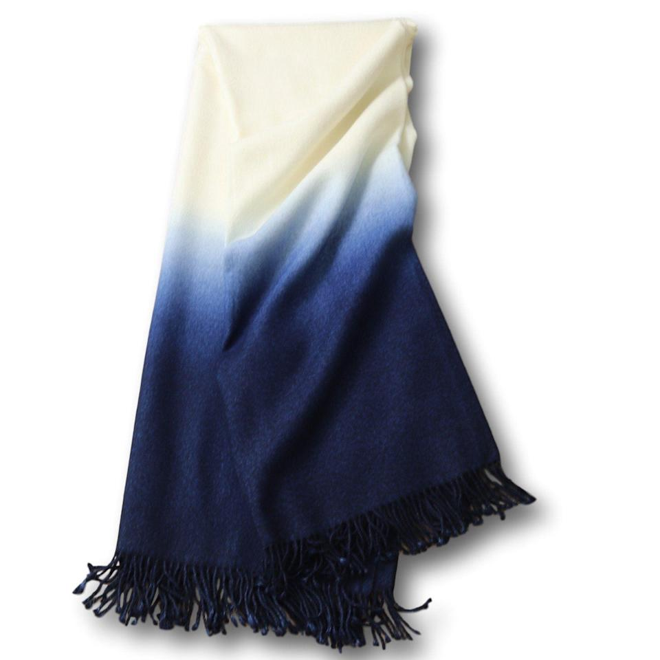 """<p><strong>Johanna Howard Home</strong></p><p>johannahoward.com</p><p><strong>$450.00</strong></p><p><a href=""""https://www.johannahoward.com/collections/throws/products/dip-dyed-throw"""" rel=""""nofollow noopener"""" target=""""_blank"""" data-ylk=""""slk:Shop It"""" class=""""link rapid-noclick-resp"""">Shop It</a></p><p><a href=""""https://www.johannahoward.com/"""" rel=""""nofollow noopener"""" target=""""_blank"""" data-ylk=""""slk:Johanna Howard Home"""" class=""""link rapid-noclick-resp"""">Johanna Howard Home</a> was founded by Swedish native Johanna Howard, who is inspired by the clean elegance of Scandinavian design. Formerly a fashion designer for brands like BCBG and Express, Howard has shifted her designing talent to the home, with high-quality pillows and throws inspired by her world travels.</p>"""