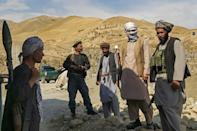 Afghan militia forces stand guard at an outpost as they patrol against the Taliban fighters in the Tange Farkhar area of Taloqan in northern Takhar province on July 6, 2021
