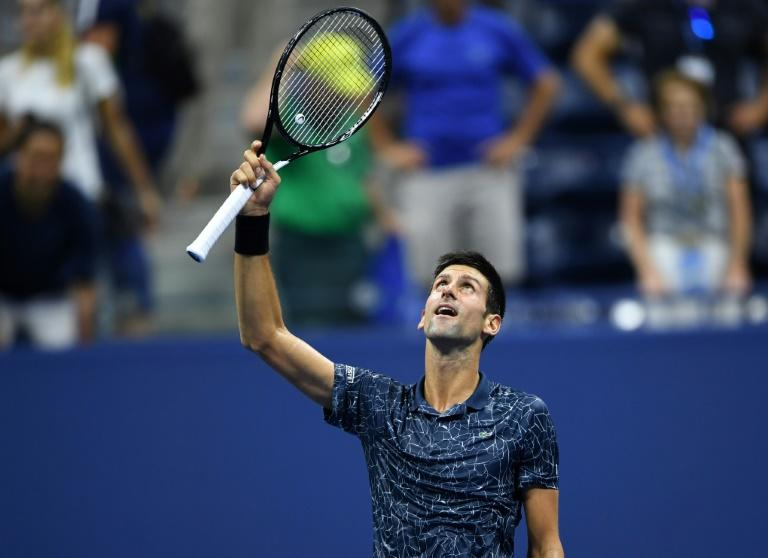 Survive and thrive: Novak Djokovic celebrates victory over John Millman in the US Open quarter-finals