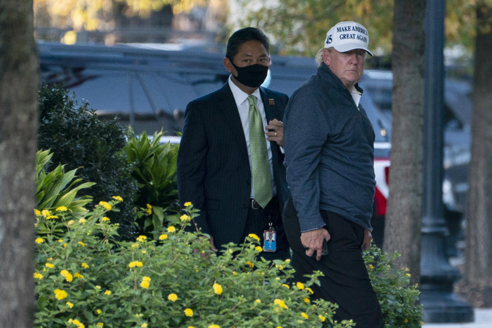 President Donald Trump returns to the White House after playing a round of golf, Saturday, Nov. 7, 2020, in Washington. (AP Photo/Evan Vucci)