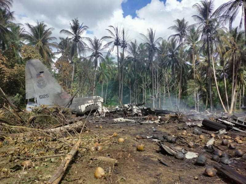 A handout photo shows debris of a Philippine Air Force C-130 cargo plane at the vicinity of Jolo airport, Sulu island, Philippines.