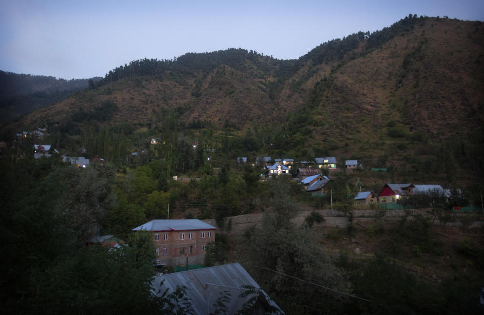 The Dardkhor village, where several cases of wild animals attacking villagers have been reported is seen at dusk on the outskirts of Srinagar, Indian controlled Kashmir, Monday, Aug. 24, 2020. Amid the long-raging deadly strife in Indian-controlled Kashmir, another conflict is silently taking its toll on the Himalayan region's residents: the conflict between man and wild animals. According to official data, at least 67 people have been killed and 940 others injured in the past five years in attacks by wild animals in the famed Kashmir Valley, a vast collection of alpine forests, connected wetlands and waterways known as much for its idyllic vistas as for its decades-long armed conflict between Indian troops and rebels. (AP Photo/Mukhtar Khan)