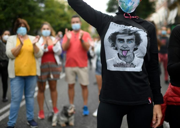 A youth wears a jersey depicting the likeness of Spanish health official Fernando Simon during a demonstration in Madrid against new restrictive measures announced by regional authorities