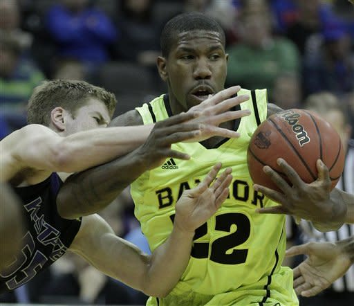 Kansas State guard Will Spradling (55) tries to steal the ball from Baylor guard A.J. Walton (22) during the first half of an NCAA college basketball first round game in the Big 12 Conference tournament, Thursday, March 8, 2012, in Kansas City, Mo. (AP Photo/Charlie Riedel)