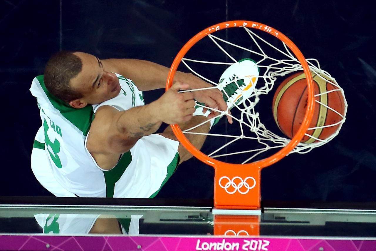 LONDON, ENGLAND - AUGUST 08:  Alex Garcia #8 of Brazil dunks the ball in the second half while taking on Argentina during the Men's Basketball quaterfinal game on Day 12 of the London 2012 Olympic Games at North Greenwich Arena on August 8, 2012 in London, England.  (Photo by Ronald Martinez/Getty Images)