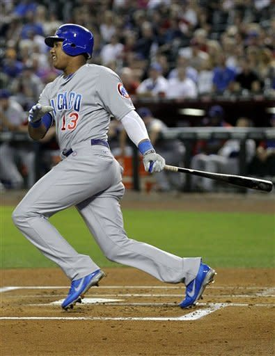 Chicago Cubs' Starlin Castro (13) connects for a base hit against the Arizona Diamondbacks during the first inning of a baseball game, Friday, Sept. 28, 2012,in Phoenix. (AP Photo/Matt York)
