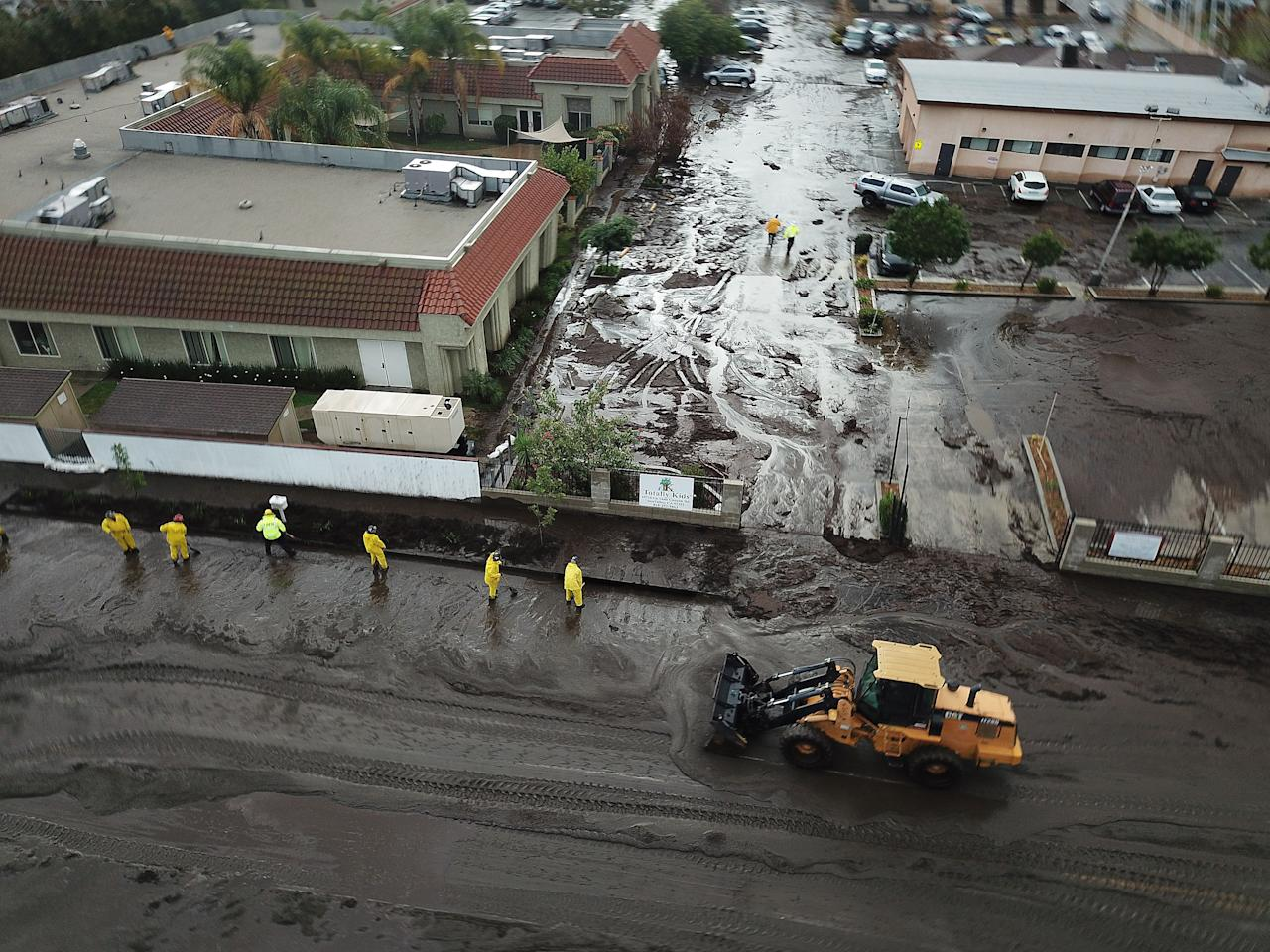 <p>Los Angeles Fire Department Firefighters work admist flood waters and mud after debris flow during heavy rains in Sun Valley, Calif., Jan. 9, 2018. (Photo: Andrew Gombert/EPA-EFE/REX/Shutterstock) </p>