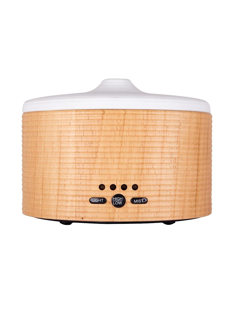 """<p>Made from sustainable wood, the Maya diffuser lasts for up to six hours and will make a stylish addition to the bedroom. The must-have features soothing mood lighting and is recommended for us during pre-bedtime meditation and aromatherapy treatments. <a href=""""https://www.nealsyardremedies.com/aromatherapy/aromatherapy-oils-and-blends/essential-oil-burners/9419.html?gclid=CjwKCAjwmq3kBRB_EiwAJkNDp0QGEPIM6VnUgHcfMpiLEkJolR7CwjbXSeKw2eihhiwJHRiTxB2UhRoCKI0QAvD_BwE#fo_c=1916&fo_k=219fdc99f84df23026bda660ddc0b220&fo_s=gplauk"""" rel=""""nofollow noopener"""" target=""""_blank"""" data-ylk=""""slk:Buy now"""" class=""""link rapid-noclick-resp""""><em>Buy now</em></a>. </p>"""