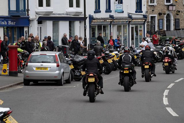 Bikers travel through Matlock Bath. (Tom Maddick / SWNS)