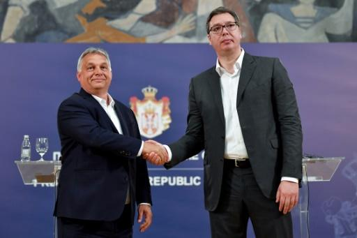 Serbian President Aleksandar Vucic (R) has deftly brought the media to heel using the same 'illiberal toolbox' as Hungary's Viktor Orban, according to the US-based Freedom House