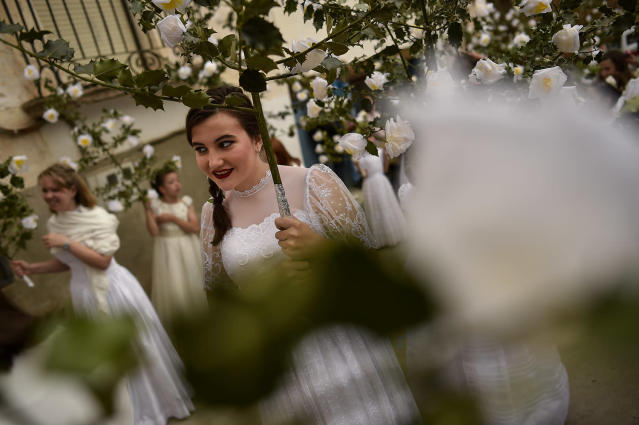"<p>Participants dressed in bridal white surrounded by flowers, takes part in the pilgrimage ""The Maidens"", in Sorzano, northern Spain, Sunday, May 21, 2017. According to ancient traditions, the pilgrimage ""The Maidens"" is in honor of the spring season and the fertility of women. (Photo: Alvaro Barrientos/AP) </p>"