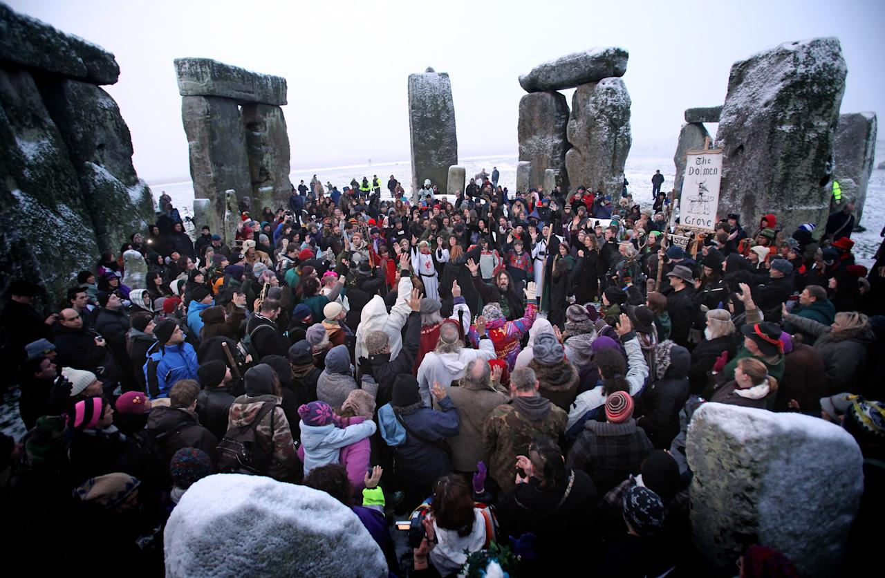 STONEHENGE, ENGLAND - DECEMBER 22:  Hundreds of druids and pagans celebrate the winter solstice at Stonehenge on December 22, 2009 in Wiltshire, England. Hundreds of people gathered at the famous stone circle to celebrate the sunrise closest to the Winter Solstice, the shortest day of the year.  (Photo by Matt Cardy/Getty Images)