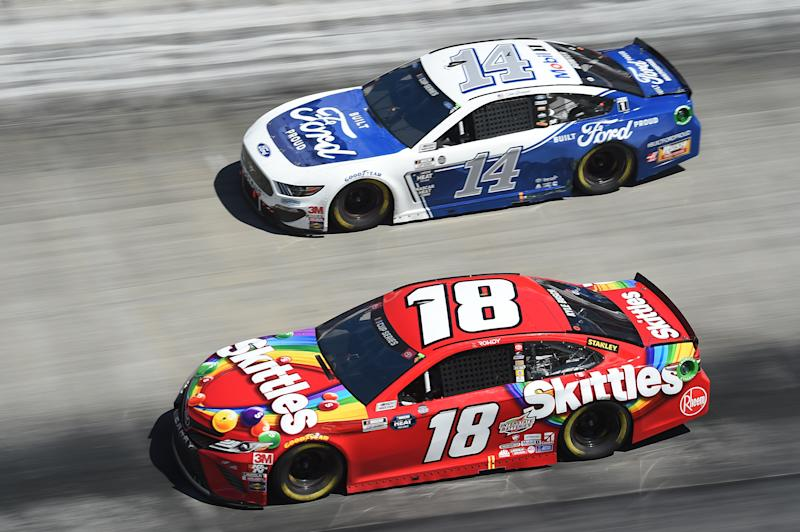 BRISTOL, TENNESSEE - MAY 31: Kyle Busch, driver of the #18 Skittles Toyota, leads Clint Bowyer, driver of the #14 Built Ford Proud Ford, during the NASCAR Cup Series Food City presents the Supermarket Heroes 500 at Bristol Motor Speedway on May 31, 2020 in Bristol, Tennessee. (Photo by Jared C. Tilton/Getty Images)
