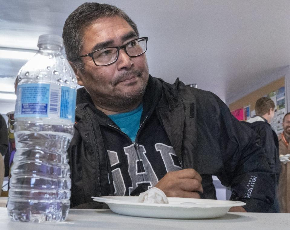 """<span class=""""caption"""">A water bottle sits on the table in front of Chief and NDP candidate Rudy Turtle during a visit by NDP Leader Jagmeet Singh on Oct. 5, 2019 on the Grassy Narrows First Nation, where industrial mercury poisoning in its water system has seriously affected the health of the community.</span> <span class=""""attribution""""><span class=""""source"""">THE CANADIAN PRESS/Paul Chiasson</span></span>"""